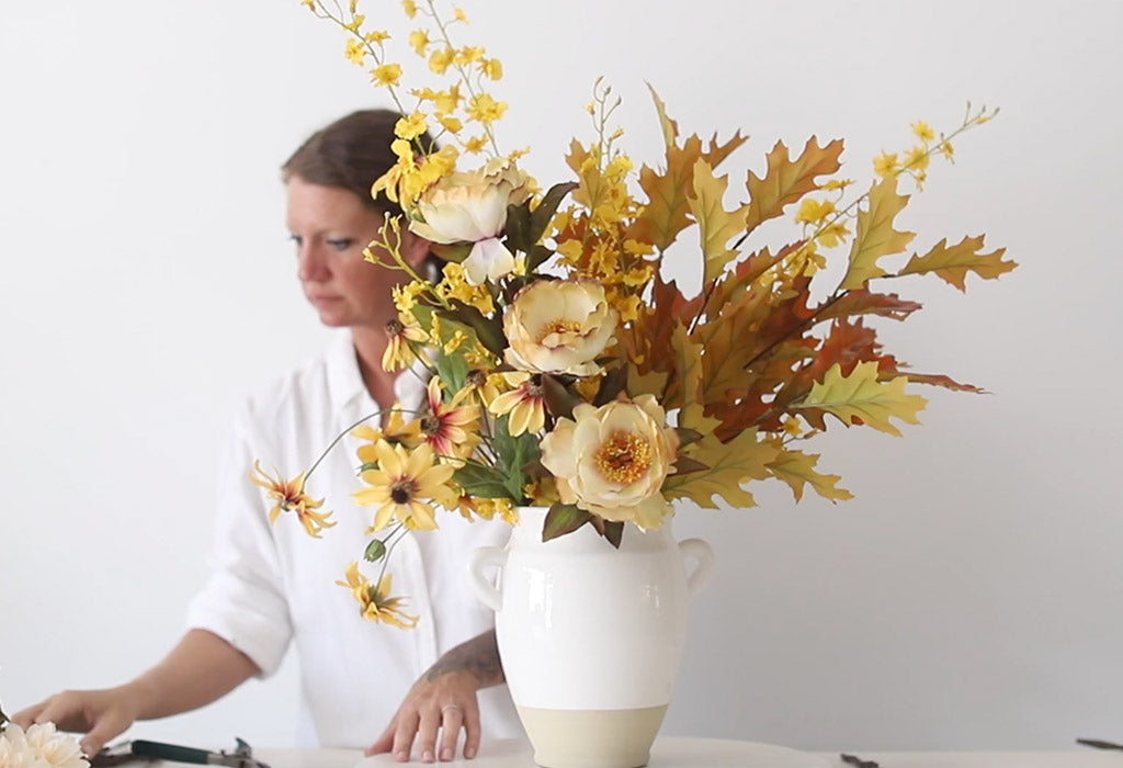 fall floral arrangement with silk flowers and fake fall leaves