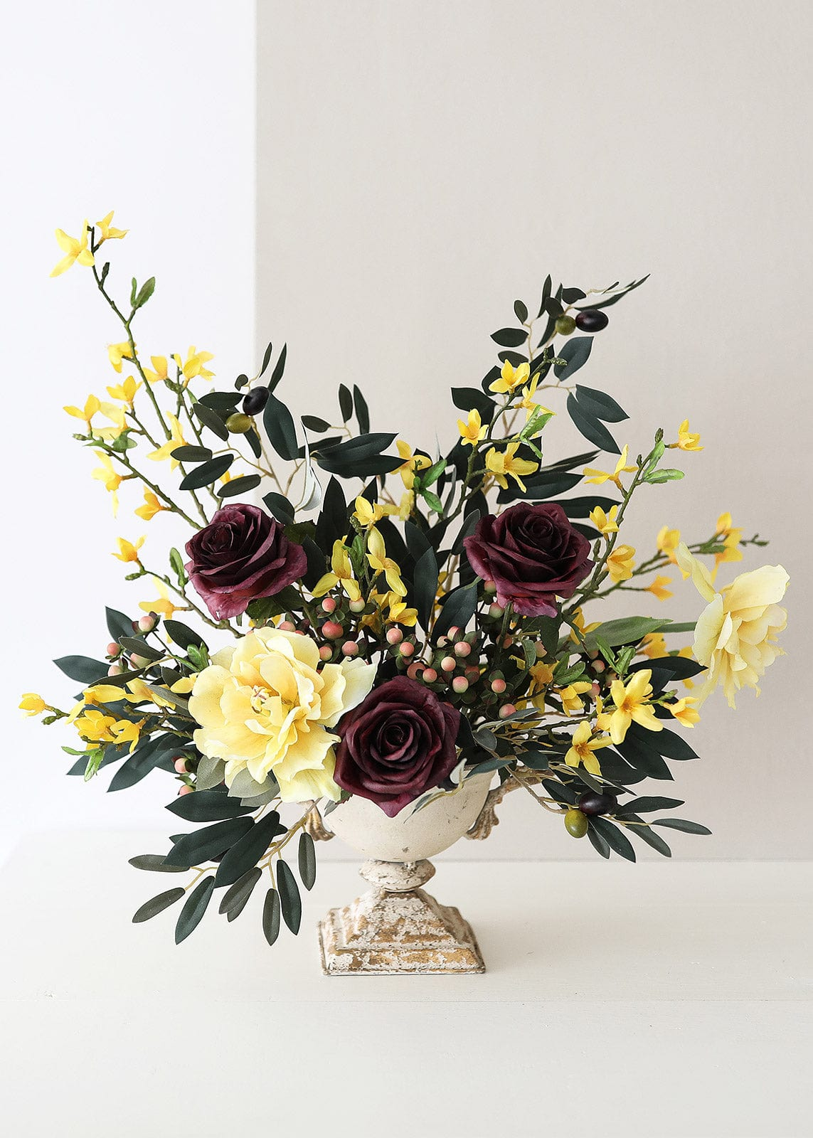 Purple and Yellow Fake Flower Arrangement in Urn