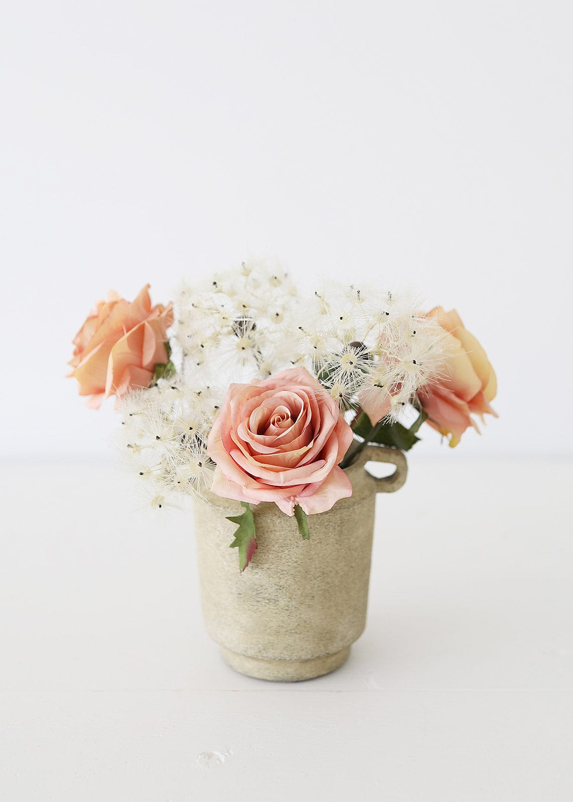 Dusty Pink Roses and Dandelion Blooms in Vase