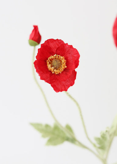Fake Flowers in Red Poppy Stem