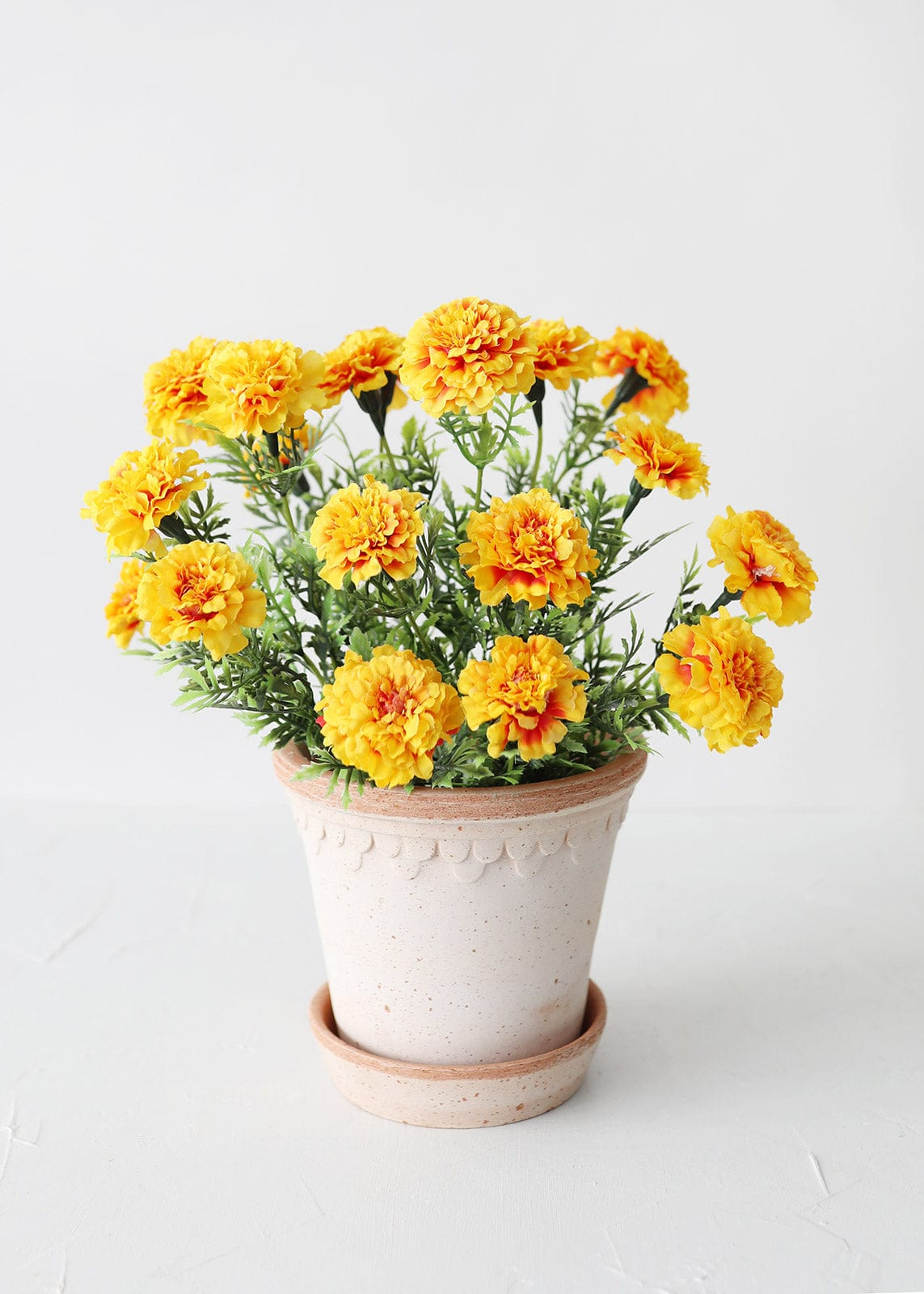 Yellow Artificial Marigold Bush in Terra Cotta Planter