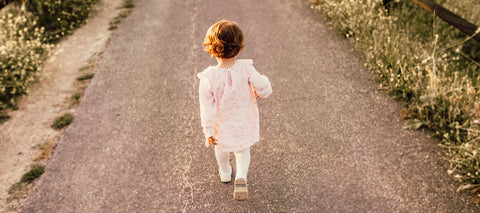 Toddler walking along country path