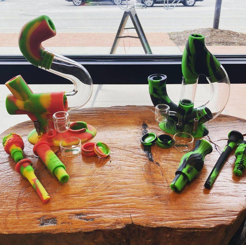 Rasta Swerve Hybrid Piece and Chameleon Echo Hybrid in front of window on wood table