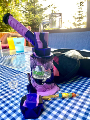 Purple Mojo Hybrid Piece on blue and white checkered picnic table outside