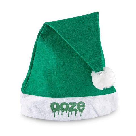 A green felt Ooze Santa hat has the Ooze logo on the white band of the hat, and it's folded over at the top with the white pom hanging down.