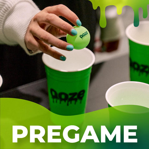 The Ooze Pregame Spotify Playlist cover. It shows a young white female with light blue nails holding a green Ooze ping pong ball over a green Ooze solo cup playing beer pong. There is a green slime detail across the bottom with the playlist title