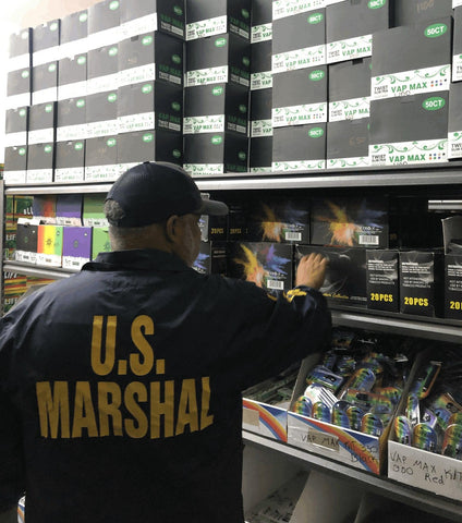 Us Marshal seizing fake ooze slim twist batteries from a counterfeit manufacturer at Texas distribution center.
