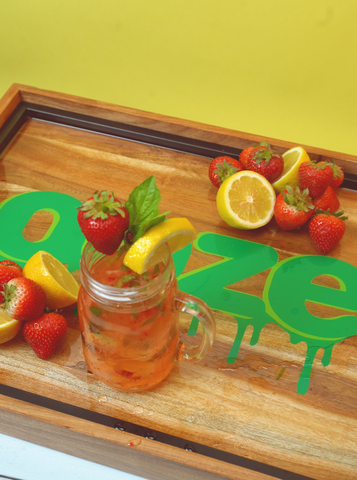 Strawberry Lemonade on Ooze wooden tray with yellow background