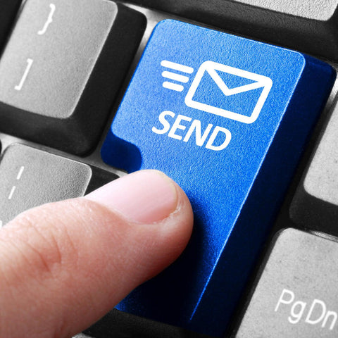 "A white person's index finger is pushing a blue keyboard button that says ""SEND"" with a moving envelope icon."
