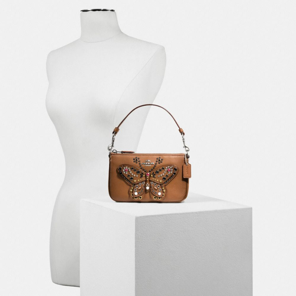 COACH LARGE WRISTLET 19 IN NATURAL REFINED LEATHER WITH BUTTERFLY STUD - PitaPats.com