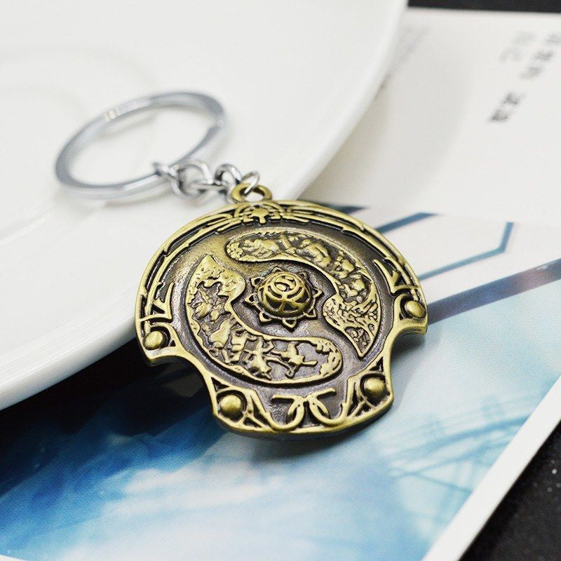 DOTA Immortal Champion Shield Keychain Keychain Buy top quality DOTA Immortal Champion Shield Keychain Keychain online in India at low price. get free shipping all across India Only at  Dot Aero