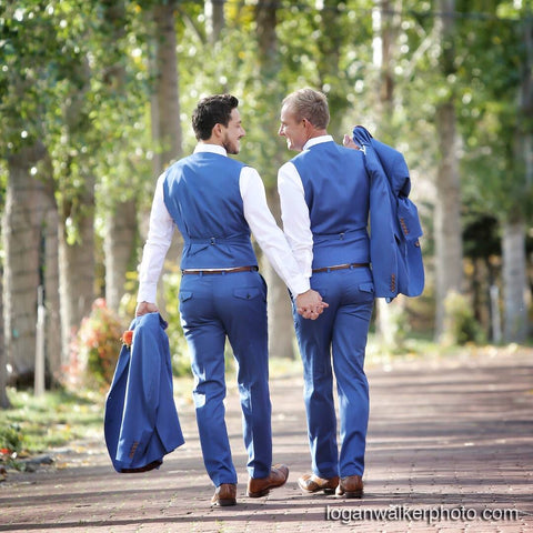 Blue suit and vest gay wedding
