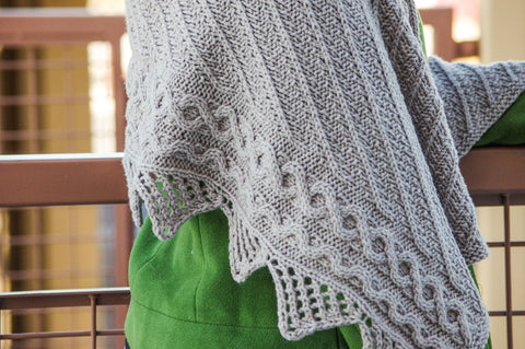 Grand Boulevard Wrap pattern by Meghan Jones, PDF knitting pattern features asymmetrical cables, lace and texture stitches.