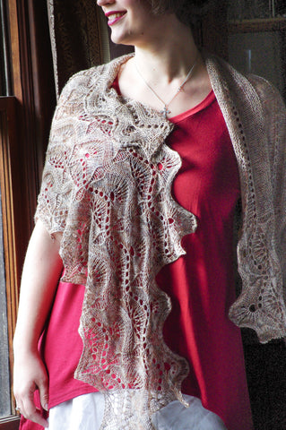 The Ostrich Race Knitting pattern, worked with fingering weight yarn and perfect for a multicolor this shawl uses an undulating stitch pattern and welted eyelets. Cast on for the length and worked with a series of bind off for shaping this beautiful shawl flutters in the wind. Knitting, pattern, lace, shawl, sock yarn, lorna's laces, Meghan Jones.