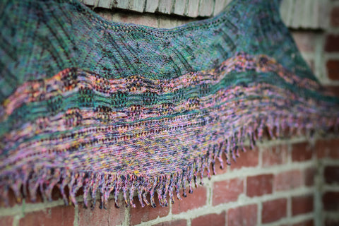 Shawlasaurus by Meghan Jones: A shawl-wearing experience 65 million years in the making! Shawlasauraus is worked with a combination of lace, garter stitch and short rows for a finished shape based loosely on a stegosauraus. This funky shawl is worked from the bottom up for a unique statement piece, but watch out, he comes with attitude!