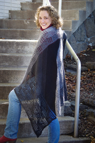 Velvet Ziggurat by Meghan Jones: The beauty of a gently curving stitch pattern combines with strong diagonal, vertical and horizontal lines, for a rectangular wrap based on a triangular shawl. The color changes of the gradient yarns are manipulated to illustrate the unusual shaping while still being allowed to naturally flow from one shade to the next.