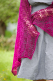 Armeria Wrap Knitting Pattern, worked with 2 strands of lace-weight yarn this pattern blends color by using 2 strands of 1 color, or 1 strand of 2 colors at the same time. Worked bottom up with an enjoyable lace pattern this wrap uses 100% cashmere yarn for a sumptuous ombre masterpiece! Check out this gorgeous knit design by Meghan Jones with yarn from Lux Adorna Knits today!