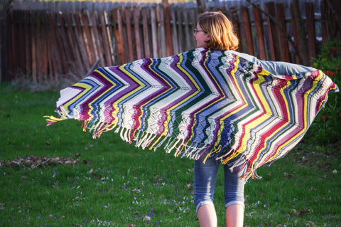 Lindy Pop: knitting pattern by Meghan Jones. Loads of fringe edge a stripey bias lace and twisted stitches shawl.