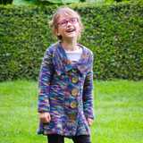 Milieu Panache is an upsized version of the popular Petite Panache pattern, worked in one piece from the bottom up with pleating and seed stitch this adorable tunic length coat is now available in sizes 6-12 years.  Knitting pattern, Meghan Jones, kids knits, sweater, cardigan, pleating, seed stitch, tunic, chunky yarn