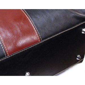 black and brown leather duffle bag