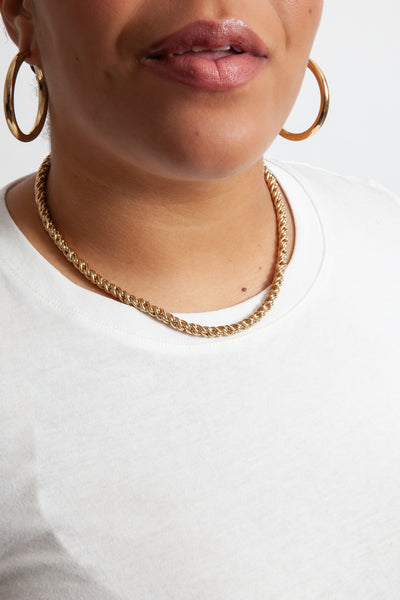 gold rope chain necklace on model