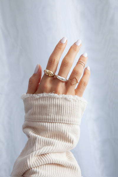Emmy Midi Rings stacked with other Miranda Frye rings