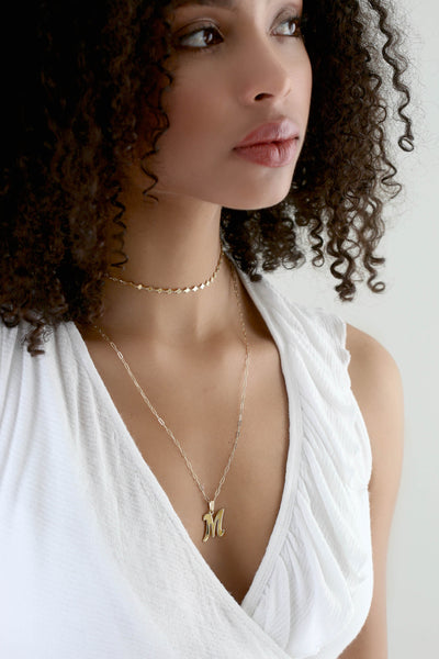 gothic gold initial M charm layered on model