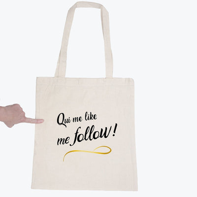 Tote bag Qui me like me follow par T-Pop