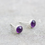 Tiny stud earrings with Amethyst stones, sterling silver
