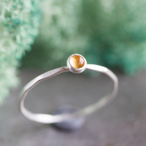 skinny silver stacking ring with golden citrine faceted gemstone