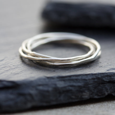 Interlocking ring made of 4 tiny bands
