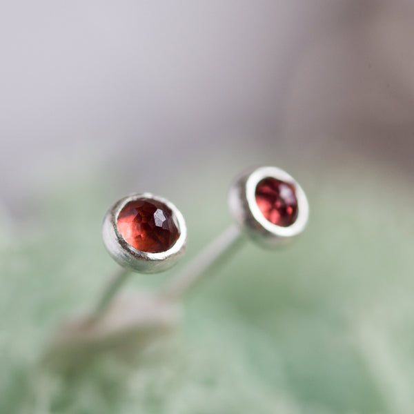 Tiny stud earrings with Almadine Garnet stones, sterling silver