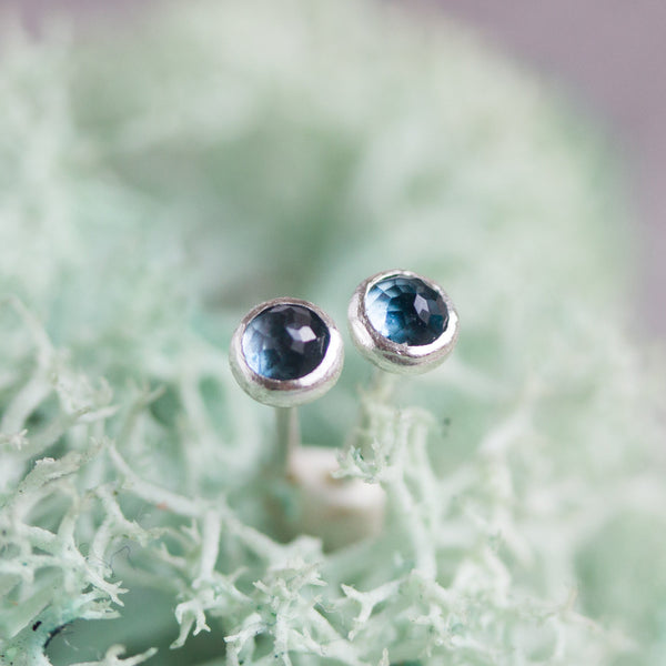 Tiny stud earrings with London Blue Topaz stones, sterling silver