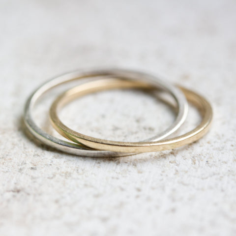 Interlocked rings made of sterling silver and brass