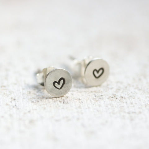 Sterling silver stud earrings with stamped hearts