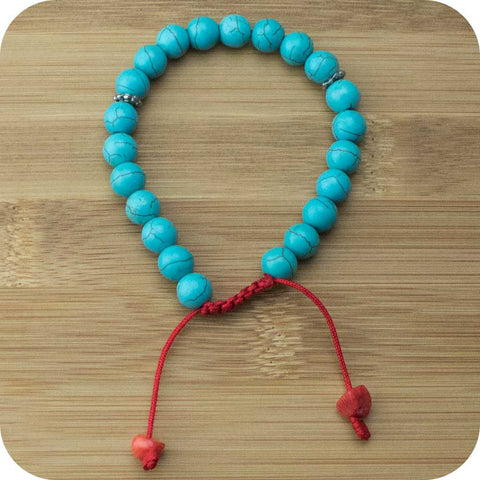 Turquoise Magnesite Wrist Mala Bracelet with Red Bamboo Coral - Meditative Wisdom