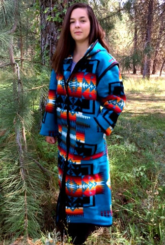 Long wool coat, turquoise, with black, orange and red geometric accents in Chief Joseph pattern by Pendleton.