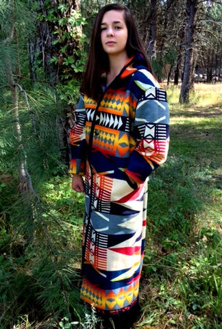 Long wool coat, multi-color blue, white, yellow, and red geometric shapes, in Fire Legend by Pendleton.