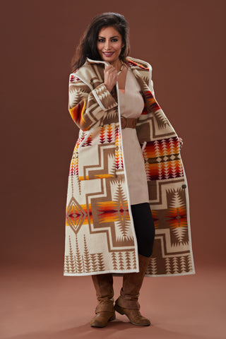 Long wool coat, ivory with tan, yellow, red and orange geometric accents in Harding Ivory by Pendleton.