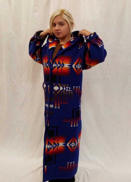 Long wool coat, sapphire blue with red, orange and back geometric accents in the Chief Joseph pattern.