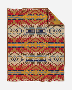 Pendleton wool blanket, geometric shapes, golds, reds, ivory and blue, called Journey West.