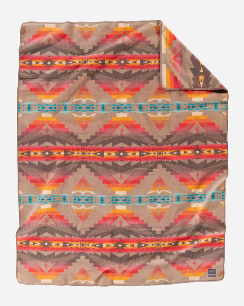 Pendleton wool blanket tans, blues, yellows, oranges and reds, in geometric patterns, called Sierra Ridge Craftsman.