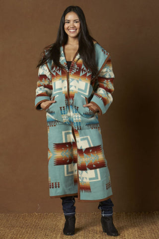 Long wool coat, aqua blue with ivory and earth tone geometric accents in the Chief Joseph pattern by Pendleton.