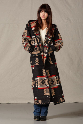 Long Pendleton wool coat, mostly black with tan geometric shapes and red accents.