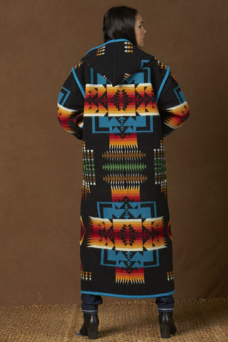 Long wool coat, black with turquoise, red and orange geometric accents in Chief Joseph pattern by Pendleton.