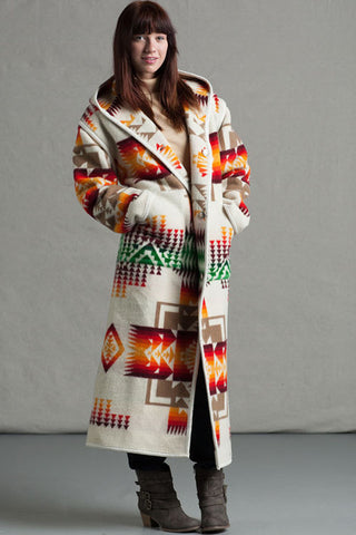 Long wool coat, ivory with tan, red, orange and green geometric accents in Chief Joseph pattern by Pendleton.