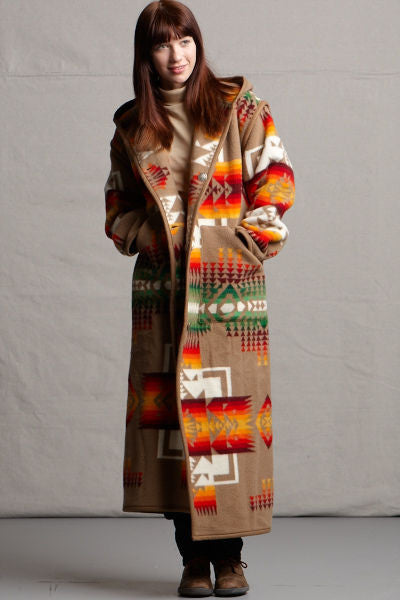 Long wool coat, khaki-brown, with ivory, red and orange geometric accents in Chief Joseph pattern by Pendleton.