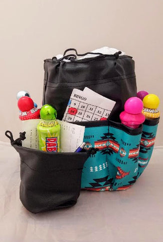 Turquoise and black bingo bag with southwestern design.