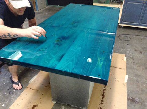 Solid fir desk top stained with tourquise and sealed with resin