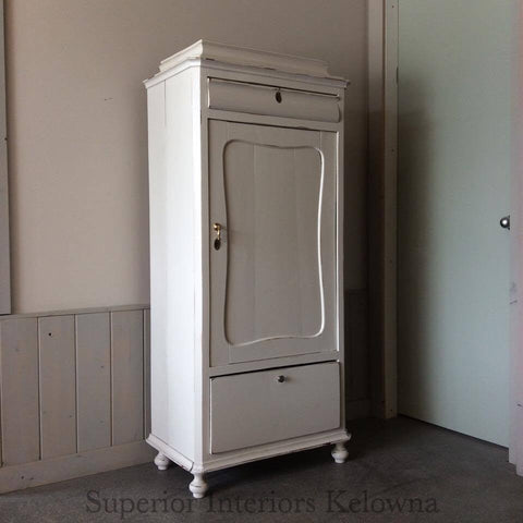 Antique bar cabinet refinished by Superior Interiors Kelowna